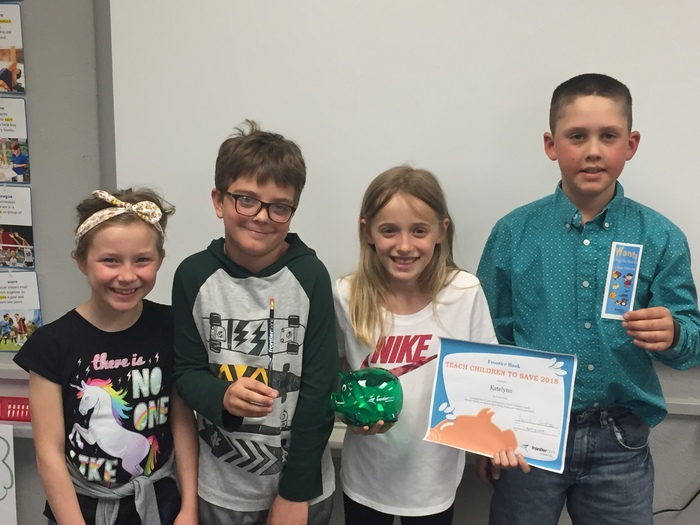 3rd Graders show off their gifts from Frontier Bank