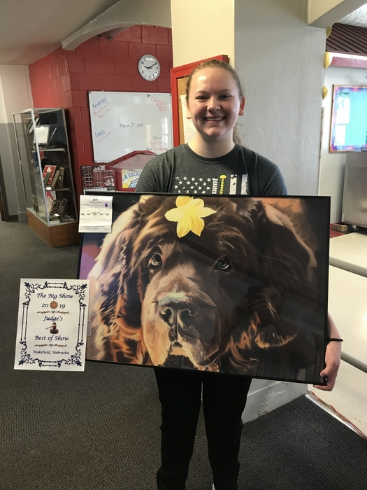 "Dawson Anderson with her colored pencil project, titled ""Doggo""."