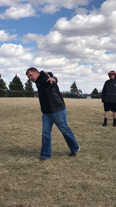 Coach Brock Simonsen patiently waiting for Discus throwers to finish warmups. 🙊🚶‍♂️